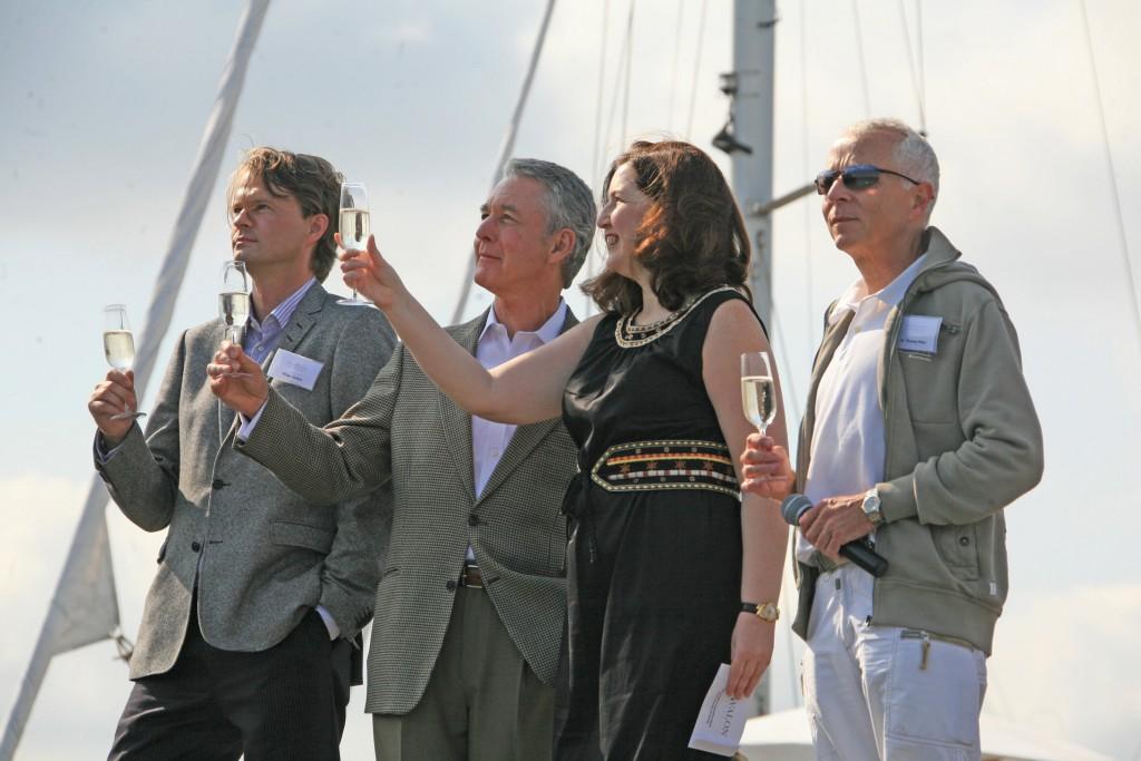 Avalon Creativity; christening; people; Godmother; toasting; champagne
